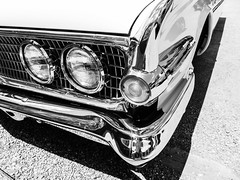 Headlights (Thad Zajdowicz) Tags: zajdowicz santafe newmexico leica availablelight outdoor outside lightroom blackandwhite highcontrast black white bw automobile car transportation detail headlights chrome classic vintage lines curves light shadow fineart