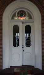 Doorway, Abram Fisk House — Coldwater Township, Branch County, Michigan (Pythaglio) Tags: abram fisk house dwelling residence historic nrhp national register places ca1863 italianate brick coldwater township michigan branch county doorway doors door entry entrance roundarched panels paneled circular stained glass window bricks blue hat coffee 89002306