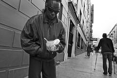 Jones Street, Tenderloin - San Francisco, CA (Rex Mandel) Tags: streetphotography street sanfrancisco sf tenderloin tl blackandwhite bw sidewalk junkie streetpeople streetperson addict cigarette sunglasses cigarettestub portrait streetportrait