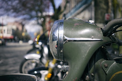 Vintage Triumph at The Shop (Eric Flexyourhead) Tags: vancouver canada britishcolumbia bc chinatown columbiastreet theshop city urban detail fragment motorcycle motorbike bike vintage old retro british triumph headlight headlamp green patina shallowdepthoffield bokeh sonyalphaa7 zeisssonnartfe35mmf28za zeiss 35mmf28