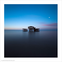 Pink Moon II / West Pier, Brighton (Andrew James Howe) Tags: andrewhowe architecture buildings clouds colour dawn england engineering fineart brightonwestpier brighton westpier horizon light landscape longexposure nikon pier reflections reflection square sky