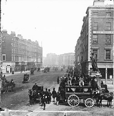 Horse-drawn Omnibus, Westmoreland Street, Dublin (National Library of Ireland on The Commons) Tags: westmorelandstreet dublin ireland leinster thomasmoore statue trams horsedrawntrams tophats shops carlislebridge oconnellbridge carriages gaslighting milliner liffey riverliffey sheep toole kingstownanddublin stereoscopiccollection stereopairs stereographicnegatives stereoscope jamessimonton frederickhollandmares johnlawrence lawrencecollection 19thcentury knifeboard horsedrawnomnibuses omnibus 1860s millinery morrison delany nationallibraryofireland