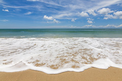 waves at a beach with blue sky (Macbrian Mun) Tags: blue sea sky beach nature water sand waves foam