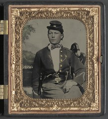 [Unidentified solder of the 26th New York Infantry Regiment with revolver in front of painted backdrop showing camp scene]  (LOC) (The Library of Congress) Tags: portrait newyork man uniform union young case ring chain backdrop libraryofcongress revolver handcolored 1860s seated xmlns:dc=httppurlorgdcelements11 dc:identifier=httphdllocgovlocpnpppmsca32650