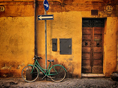 Roman style (jimiliop) Tags: street door old travel blue italy brown rome color colour roma building bike bicycle sign yellow stone wall contrast alley turquoise retro neighborhood trastevere dirt numbers arrows picturesque bold bestcapturesaoi elitegalleryaoi mygearandme