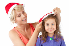 mother and daughter together in christmas hats (Konstantin Yolshin) Tags: santa christmas family blue red two portrait people woman white holiday cute love girl beautiful beauty smile look hat childhood smiling female studio mom fun happy person navidad kid couple pretty child looking little background joy daughter young mother lifestyle happiness mum parent together positive cheerful generation isolated caucasian