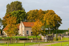 Historical lock Dirksland, with trees in autumn color (BraCom (Bram)) Tags: autumn trees house holland fall barn canon fence bomen lock herfst cottage nederland thenetherlands kanaal huis sas channel sluis hek moorings schuur zuidholland goereeoverflakkee southholland canonef70200mm meerpalen dirksland bracom canoneos5dmkiii