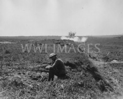 WWI0034B1 (ww1images) Tags: relax landscape soldier track post path smoke brodie helmet shell sit barbedwire british explode detonate tunic allied puttee