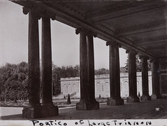 1944 black and white photo postcard of the peristyle of the Grand Trianon which was built in the northwestern part of the Palace of Versailles at the request of King Louis XIV, (thstrand) Tags: park bw france building history tourism museum architecture facade buildings french outside outdoors photography blackwhite europe european exterior architecturaldetail 17thcentury columns nobody courtyard palace halftone souvenir versailles pillars picturesque royalty monarchy grandtrianon colonnade portico ionic palaceofversailles keepsake peristyle 1600s photopostcard kinglouisxiv historicsite aristocracy aristocratic yvelines historicsites chateaudeversailles traveldestinations historicphotos chteaudeversailles rgionparisienne historicalphotograph traveldestination builtstructure 1680s ancienrgime builtstructures maitresseentitre ancientregime ledefranceregion columnedporch marquisedemontespan matresseentitre opencolonnade