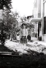 000032 (ikbals) Tags: camera portrait blackandwhite girl kids contrast canon shadows child bokeh littlegirl analogue filmphotography lightandshade analoguecamera outdoorlight kidportrait outdoorportrait girlwithcamera ilfordpan analoguelove