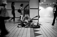 Town Hall Station - Sydney (forayinto35mm) Tags: travel blackandwhite musician music film 35mm 50mm oz sydney streetphotography australia trainstation busker delta100 busking ilford ilforddelta100 minoltadynax5 blackandwhitefilm townhallstation filmisnotdead believeinfilm