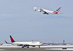 You Say Goodbye, I say Hello - East West Edition (MIDEXJET (Thank you for over 2 million views!)) Tags: chicago chicagoillinois chicagoohare ohare ohareinternationalairport ord kord airport airplane airline jet americanairlines boeing777200er n788an deltaairlines boeing767332er n171dn illinois unitedstatesofamerica boeing boeingcommercialaircraft boeingcommercialairplanecompany chooseohare fly2ohare flyohare