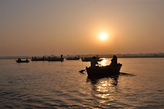 Sunrise on the Ganges [Explored] (The Spirit of the World) Tags: sun sunlight india sunrise river boats religious islam buddhism varanasi spiritual hinduism rowboats ganges autofocus famousrivers theholyriver rememberthatmomentlevel1