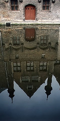 Reflection (Atomic Eye) Tags: bruges belgium water reflection door arch brick architecture film minolta7xi capital westflanders canal medieval building city veniceofthenorth