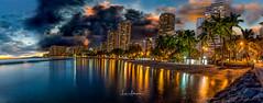 In the Eye of the Waikiki Storm (JUNEAU BISCUITS) Tags: waikiki clouds cloudscape hotels oahu honolulu hiltonhawaiianvillage royalhawaiian resort beach ocean panorama pano storm sunset nikond810 nikon longexposure leefilters