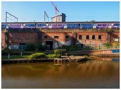 Train on High (jason_hindle) Tags: train unitedkingdom viaduct northernrail manchestershipcanal manchester