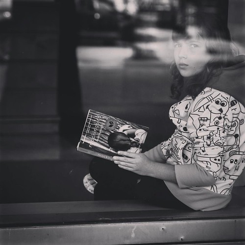 Daddy's Gonna Buy You a Mockingbird  Always love to see children reading real paper books.     #instablackandwhite #streetleaks #monochrome #blackandwhitephotography #bwphotography #bnw_life #streetview #bnw_street #streetphoto #youngreaders #booksarelife