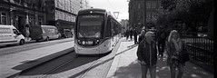 Edinburgh Trams. (christopherhogg1) Tags: chrishoggsphotos edinburgh standrewssquare edinburghtrams trams road stree tramlines pedestrians vans motorvehicles buildings scotland architecture tree streetscene city xpan