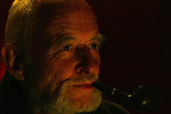 Peter In Candle Light (Jungle C) Tags: man portrait pipe smoking candle light bar eyes old