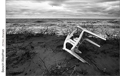 Beach Weather (jwvraets) Tags: beach twentymilecreek thetwenty jordanharbour lakeontario lawnchair broken storm waves monochrome blackandwhite bw opensource rawtherapee gimp nikon d7100 nikkor18105mmvr