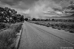 Owens Valley - Distant Downpour (www.karltonhuberphotography.com) Tags: 2014 bw blackandwhite clouds countryroad downpour drama easternsierra horizontalimage karltonhuber leadinglines monochrome naturalworld nature nikond7000 outdoors owensvalley rain raining ranchland sky storm tension weather
