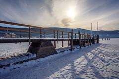 Stasis (simonpe86) Tags: deutschland sunset see himmel schwarzwald dusk rays sonnenstrahlen blue beautiful blau sky bridge titisee sonnenuntergang gefroren clouds