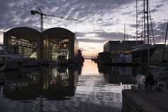 il pescatore #1 (marco monetti) Tags: viareggio thesea ilmare thesky ilcielo waterreflections riflessisullacqua fisherman pescatore shipyard cantierenavale crane gru sunset tramonto