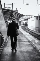 On The Turning Away. (sdupimages) Tags: candid eurostar station portrait dof bokeh walking man nb bw noirblanc blackwhite
