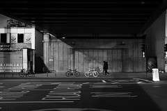 Black and also White (Florian Bütow) Tags: city street contrast light urban building bicycle white london uk england black walking pedestrian rays 40mm photography