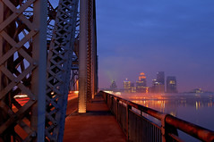 Early Morning - Louisville, Kentucky (Brett Streutker) Tags: louisville kentucky ohioriver blue bridge traffic dusk night nightlife nighttime river sunset building builtstructure city cityscape contemporary downtown horizon horizonoverwater illuminated longexposure hdr panoramic skyline skyscraper travel traveldestination urbanscene morning dawn commute drive