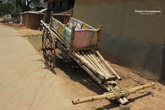 ABANDONED CART (Munisch) Tags: morning travel light india color canon geotagged photography eos rebel photo focus asia village mud wheels poor huts vehicles 1855mm roads cart stillphotography 550d bolpur t2i abandonnedbamboo