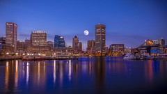 Moon, Blure Hour and Baltimore Downtown (dpbirds) Tags: nightphotography moon canon exposure cityscape baltimore multipleexposure multiple bluehour baltimoreinnerharbor longexpouser canon24105f4is baltimoredowntown canon5dmkiii supermoon darshanvaishnav baltimorenightshot