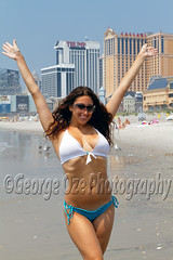 Young Woman in Bikini Standing on a Beach with Hands Up in the Air and Smiling, Atlantic City, New Jersey (George Oze) Tags: summer people woman usa sexy beach beautiful smiling vertical closeup fun outdoors happy newjersey model boobs unitedstatesofamerica longhair scenic posing lifestyle happiness curvy exotic curly bikini shore attractive atlanticcity northamerica highkey monmouthcounty brunette cheerful waving jerseyshore handsup bathingsuit beautifulpeople alluring lowangle caucasian selectivefocus wavyhair beachactivity toothysmile newjerseyshore highrisebuildings onewomanonly caucasianethnicity modelreleased 34length 2025yearsold