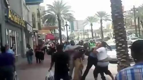 Video Police officers stand by as a man beats up a woman
