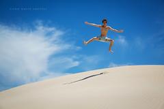 Jump (john white photos) Tags: beach fun coast jumping sand dune australia teenager relaxation southaustralia eyrepeninsula traviswhite sleafordbay