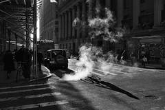 wall st (zip po) Tags: street light blackandwhite sunlight newyork monochrome mono steam wallst
