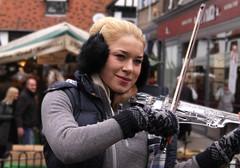 Christmas street musician (Wilamoyo) Tags: york musician girl smile dof bokeh blond violin ear busker violinist muffs xmas2013