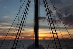 Sunset (ronniedankelman) Tags: travel sunset red water yellow clouds canon indonesia boot boat zonsondergang asia ship horizon wolken mast geel rood indonesie maluku azie reizen schip molukken matahariku bandasea papuamaluku bandazee