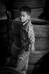 Boy (Kristoff Documentary Photographer) Tags: poverty street boy bw yellow kid cambodia poor phnom penh