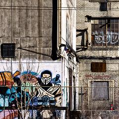 Abandoned Building (Karen Dixon Photography) Tags: demolish demo graffiti colorado grafitti decay urbandecay demolition denver urbanart superhero warrior boardedup samurai protector brokenwindows teardown gatesrubberplant abadonedbuilding suiperhero