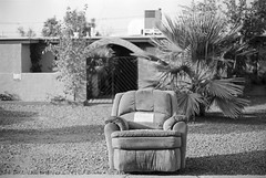 Somewhere in East Phoenix (GC_Dean) Tags: street city arizona urban blackandwhite house film home phoenix 35mm morninglight blackwhite chair flora cityscape shadows space structure 35mmfilm frontyard mundane emptiness selectivefocus oldchair emptychair sociallandscape