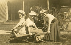 Three Women with Hats and a Wheelbarrow (Alan Mays) Tags: ephemera postcards realphotopostcards rppc photos photographs foundphotos portraits wheelbarrows pushing riding women clothes clothing hats dresses smiles smiling lawns yards porches humor humorous funny amusing antique old vintage