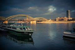 Allegro (Gilderic Photography) Tags: cologne germany rain river boat bridge rhein light cityscape canon 500d gilderic city