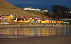 Sunny Interlude (jerryms) Tags: scarborough noth bay beach huts color colour reflection sea seaside bright stripes olympus omd em 5 panasonic 35100