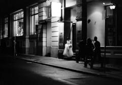 131-D63/028 (Jock?) Tags: melbourne victoria australia flinderslane night street candid bride wedding unhappy probably documentary photojournalism reportage film vintage retro kodak tmax 400 tmy2 5053 pushed 2 ei 1600 rodinal nikon fe2 nikkor 35mmf2ai ai 35mm 12