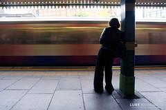 Waiting at West Kensington Station (Luke Agbaimoni (last rounds)) Tags: silhouette shadows lighttrails lights train transportforlondon londonunderground londontube london uk underground metro wait waiting