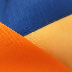 Double orange, one blue (Monceau) Tags: orange blue orangeandblue macromondays abstract fabric texture