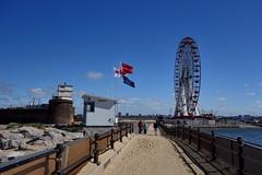 New Brighton (Lydie's) Tags: newbrighton wirral merseyside bigwheel coastguardstation flags fortperchrock sand railings people windfarms rnli