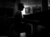 A Little Night Music. (Neil. Moralee) Tags: neilmoralee dark shadow music piano woman player pianist cark cuba seat seated silhouette black white bandw bw mono blackandwhite monochrome neil moralee quiet artist artistic calm girl darkness low light canon a480 powershot