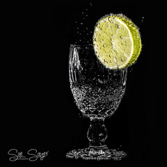 Lime & Soda. (Sue Sayer) Tags: lime fruit bubbles glass waterford low key fizz fizzy soda water flash ocf